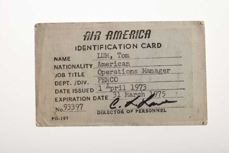 Identification card for Air America with personal details of Tom Lum filled in.