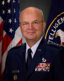 General Michael V. Hayden in front of the American and CIA flags.