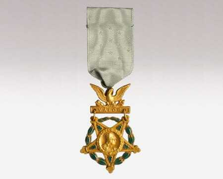 A green and gold medal of honor