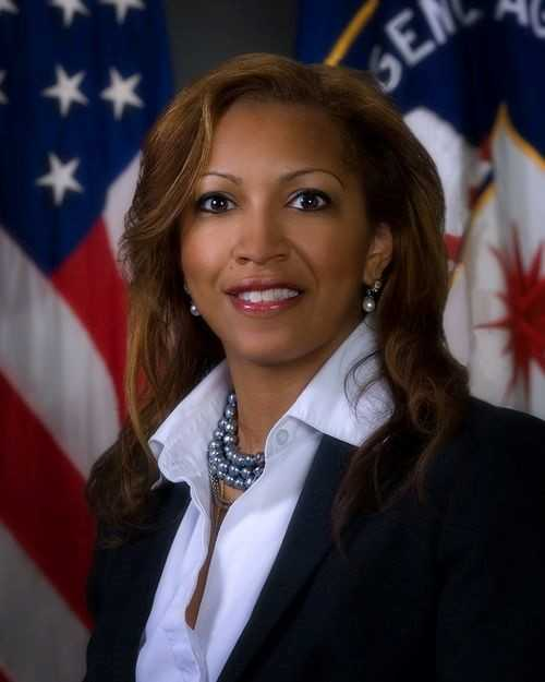 Sonya Holt, Chief Diversity and Inclusion Officer, with both American and CIA flags in the background.