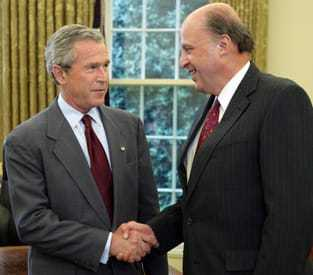 Director of National Intelligence (DNI) John Negroponte shaking hands with President George W. Bush.
