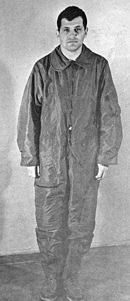A black and white photograph of Gary in a baggy Soviet prison uniform.