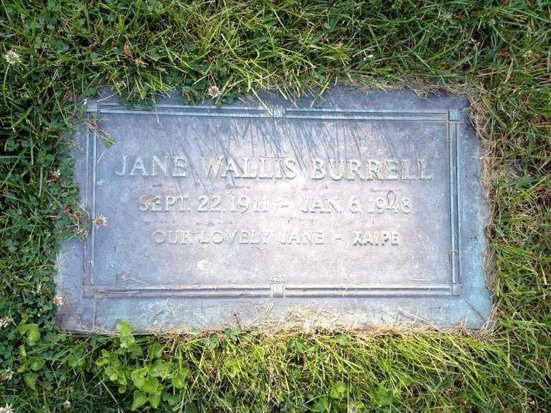 A color photograph of Jane's tombstone plaque with her name and date of death inscribed.