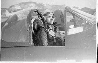 Black and white image of Norman Schwartz in an airplane
