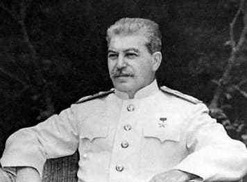 Image of Joseph Stalin sitting in a chair.