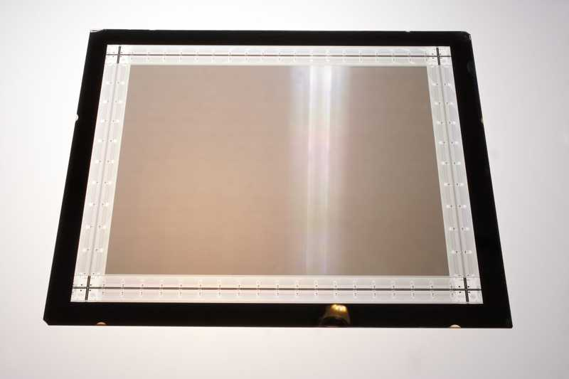 A rectangular piece of glass, with white and black frames