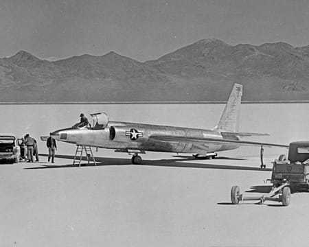 Black and white photo of a U-2 spy plane on ground with mountains in the background.