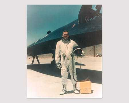 A photograph of an A-12 pilot pictured next to an aircraft.