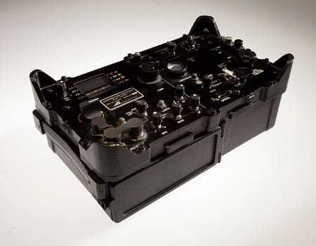 A side angled view of a black box with knobs and radio dials.