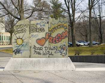 A segment of the Berlin Wall on display at a park.