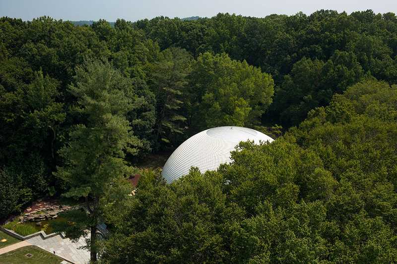 An aerial view of the CIA Headquarters Auditorium, surrounded by trees.