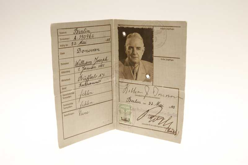 A German ID booklet with the personal details of William J Donovan, his picture, and his signature