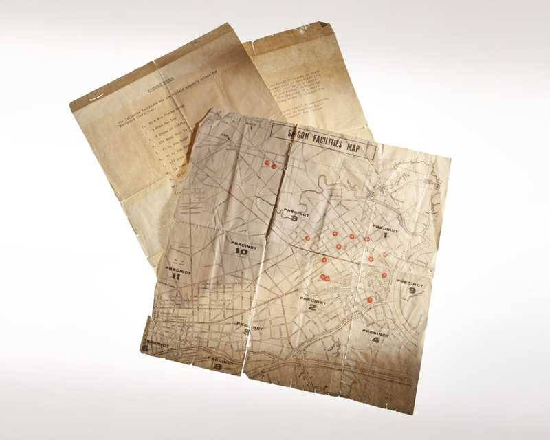A yellowed and worn map of Saigon with the title Saigon Facilities Map