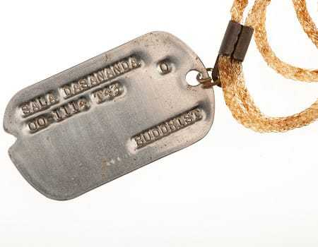 A close-up of the metal dog tag.