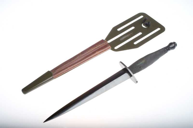 A short silver knife, alongside a wooden sheath