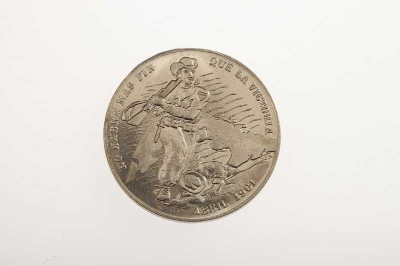 A silver coin depicting a Cuban rebel during the Bay of Pigs and dated April 1961.