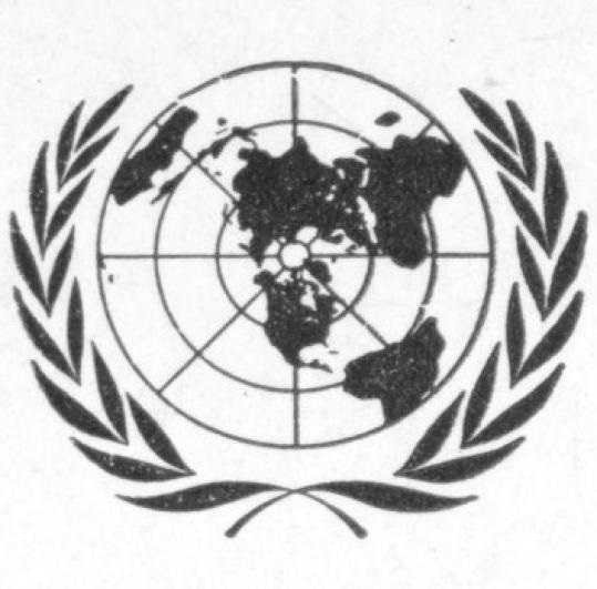 A black and white photograph of the UN prototype emblem. A black and white target-shaped globe encases a map of the world that is centered on North America and Europe. Laurels wrap around it.