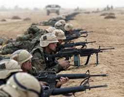 An image of military men with rifles in laying in a row during Operation ENDURING FREEDOM.