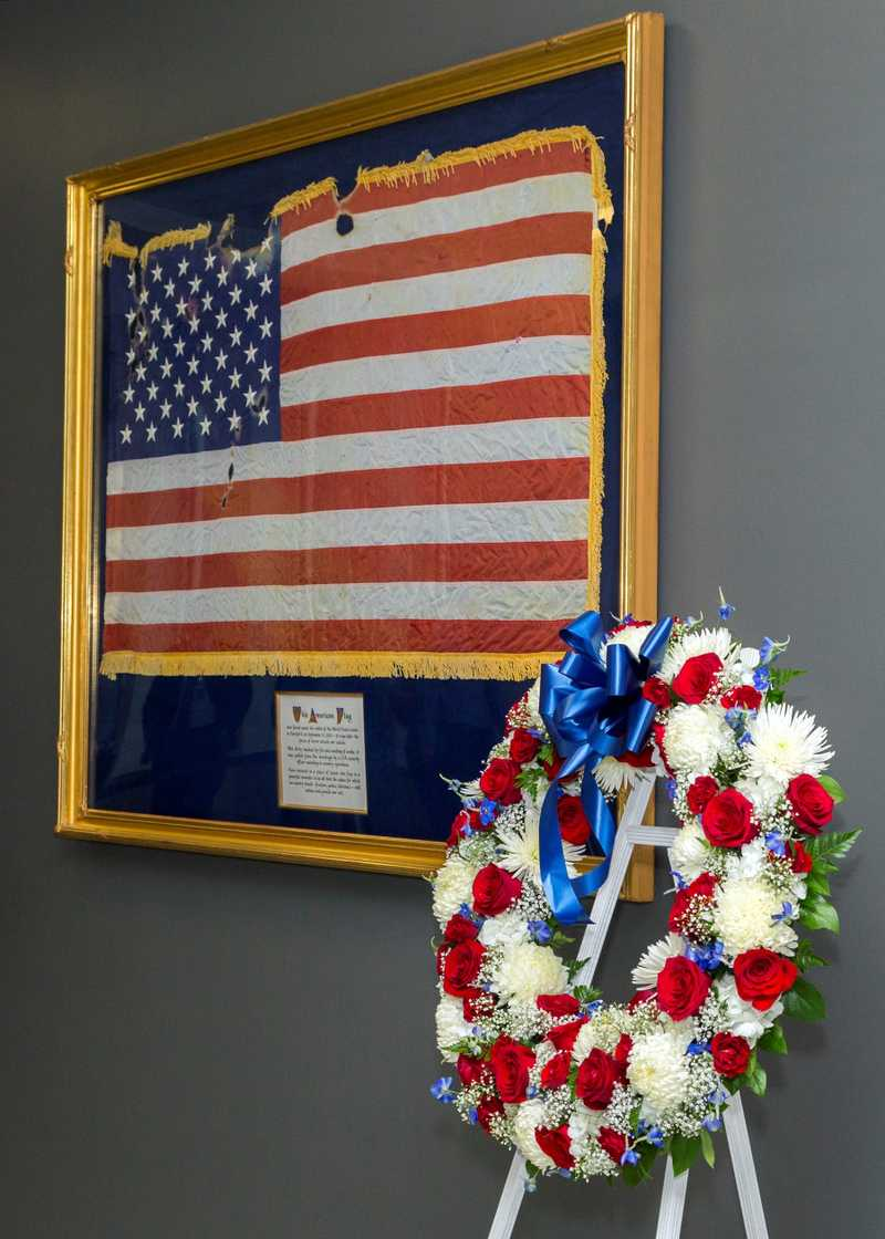 Image of a framed flag that was present during the 9/11 Attacks.