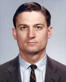 Headshot of a man in a suit.