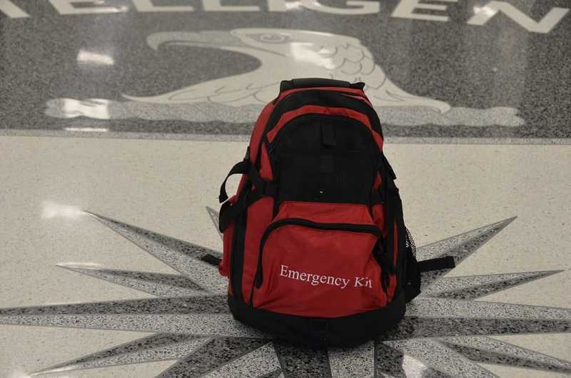 A red and black backpack with the words