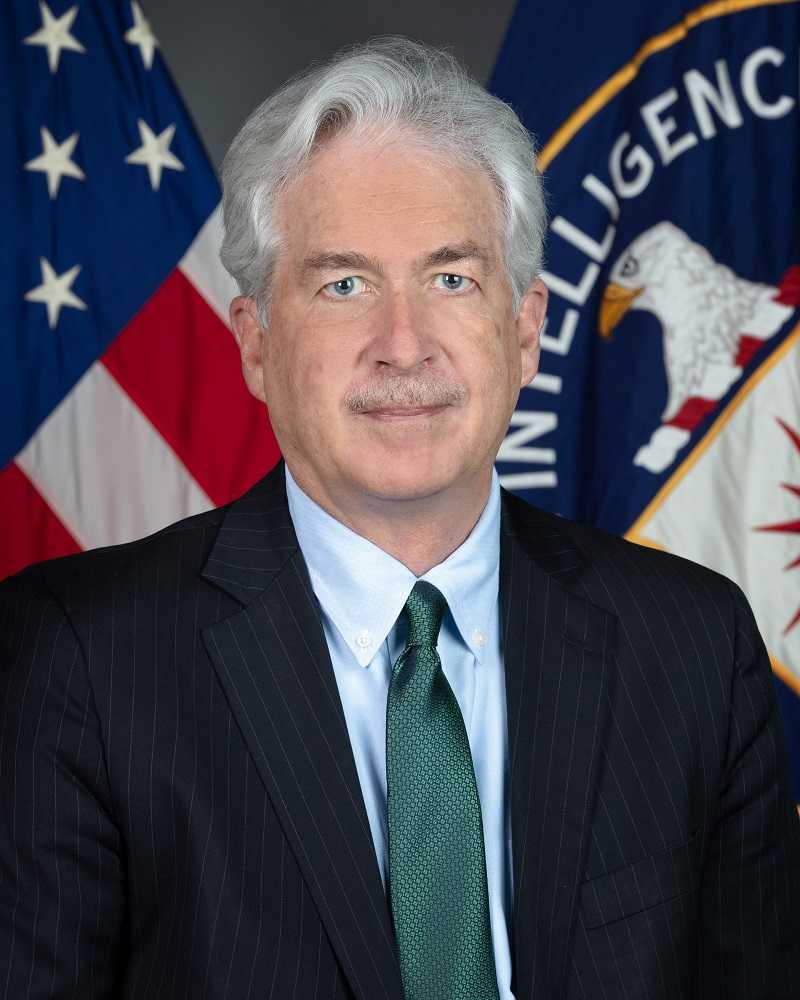 DCIA William Burns portrait with both American and CIA flags in background.