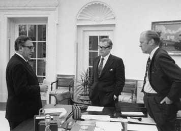 President Ford and two other men meeting in the Oval Office.