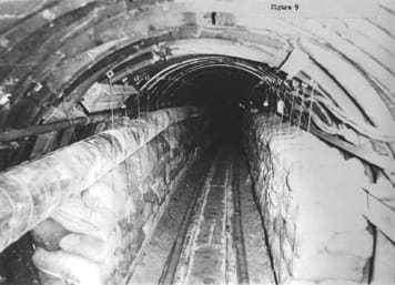 Black and white photo down the Berlin Tunnel.