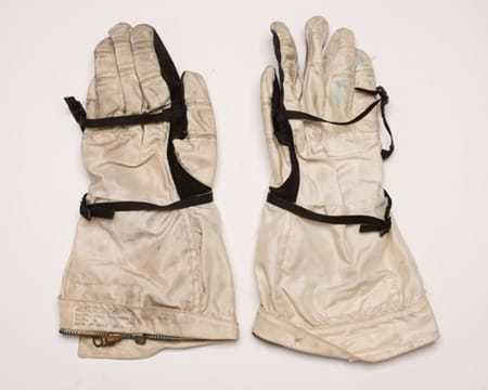 A pair of heavy duty white and black gloves