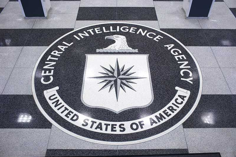 A large black, white, and gray granite version of the CIA seal.
