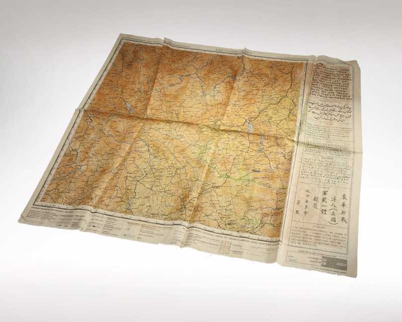 A large map printed on silk with information in multiple languages printed alongside