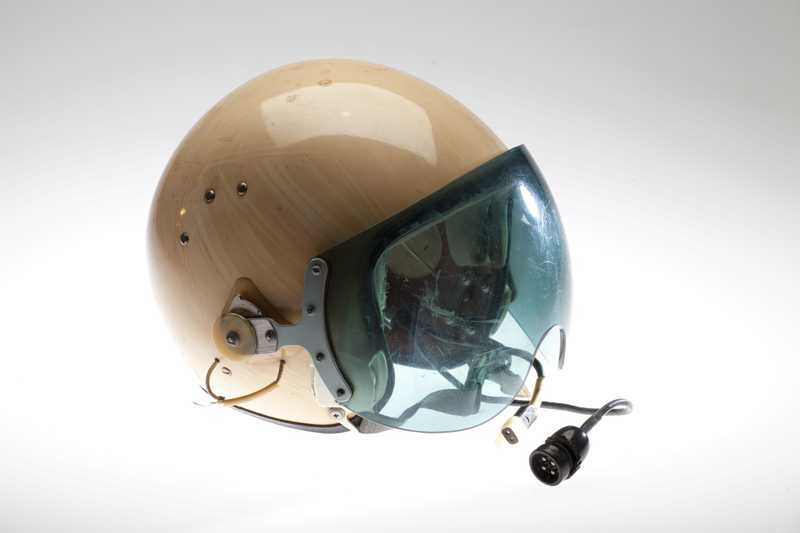 A light tan pilot's helmet from a Soviet helicopter