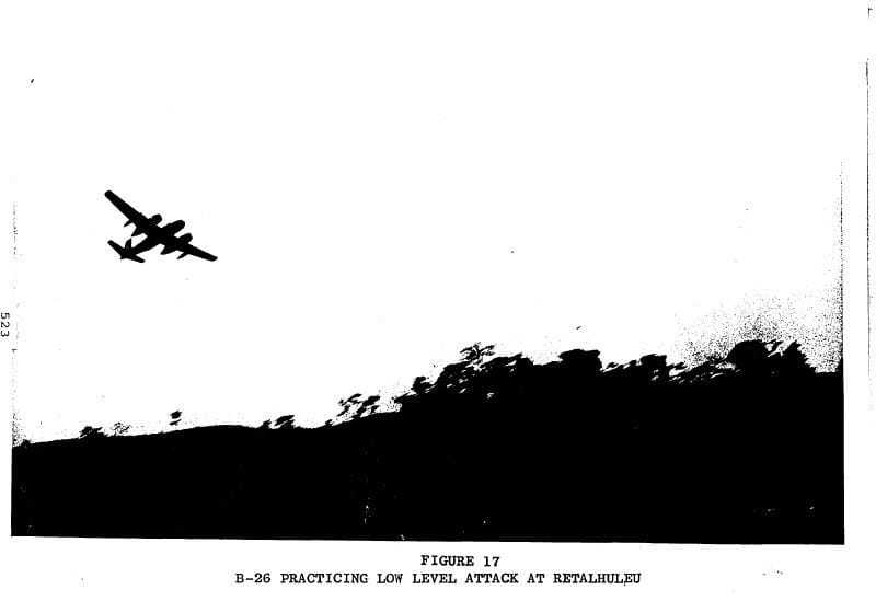 A black and white diagram of a B-26 flying over the ground.