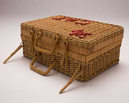 A side view of the wicker basket with several handles