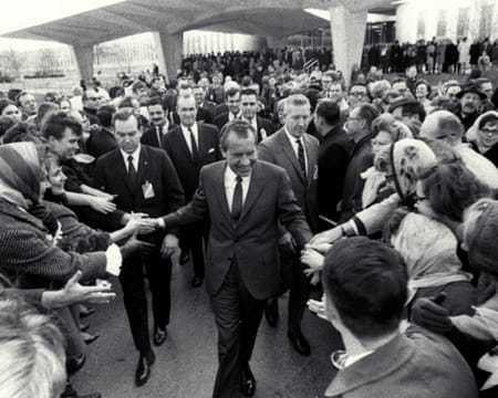 President Nixon shaking hands in a crowd of people.