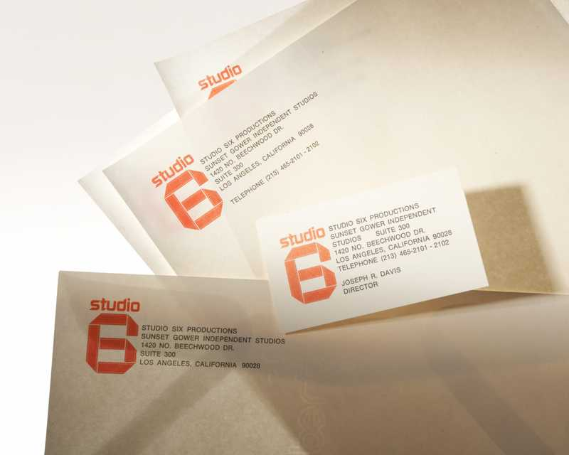 Business cards with the Studio Six logo and information