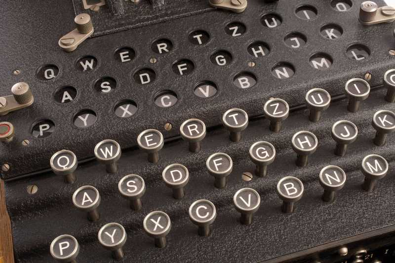 A close-up of a black typewriter.
