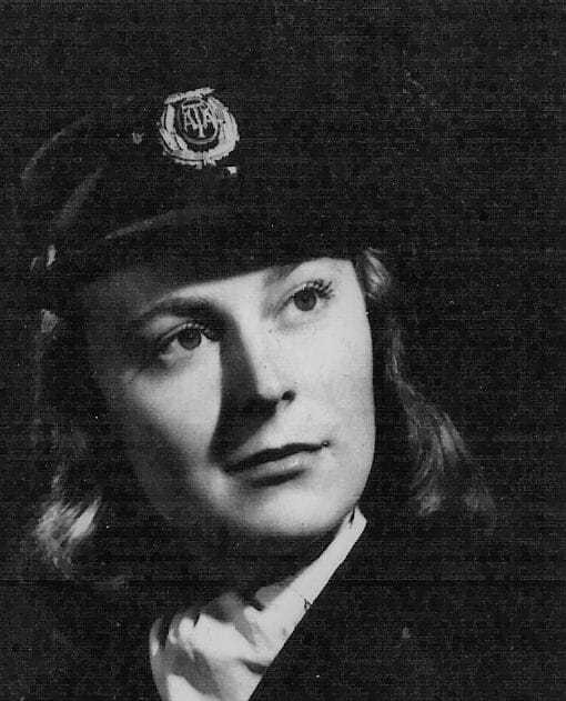 A headshot of Betty Ann Lussier in her pilot hat.