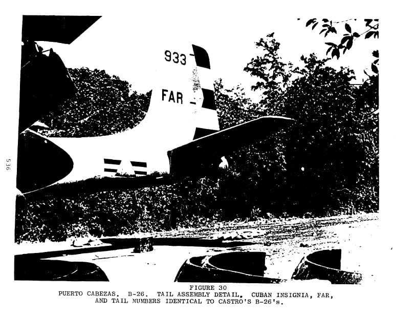 A black and white photograph of a B-26 tail with the ID: