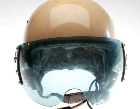 A close view of the blue-tinted visor on the Soviet pilot's helmet